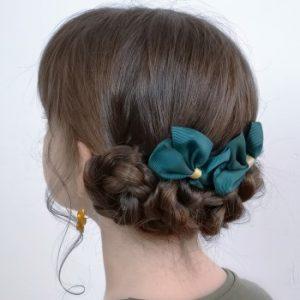 peinado de fiesta con moños bajos